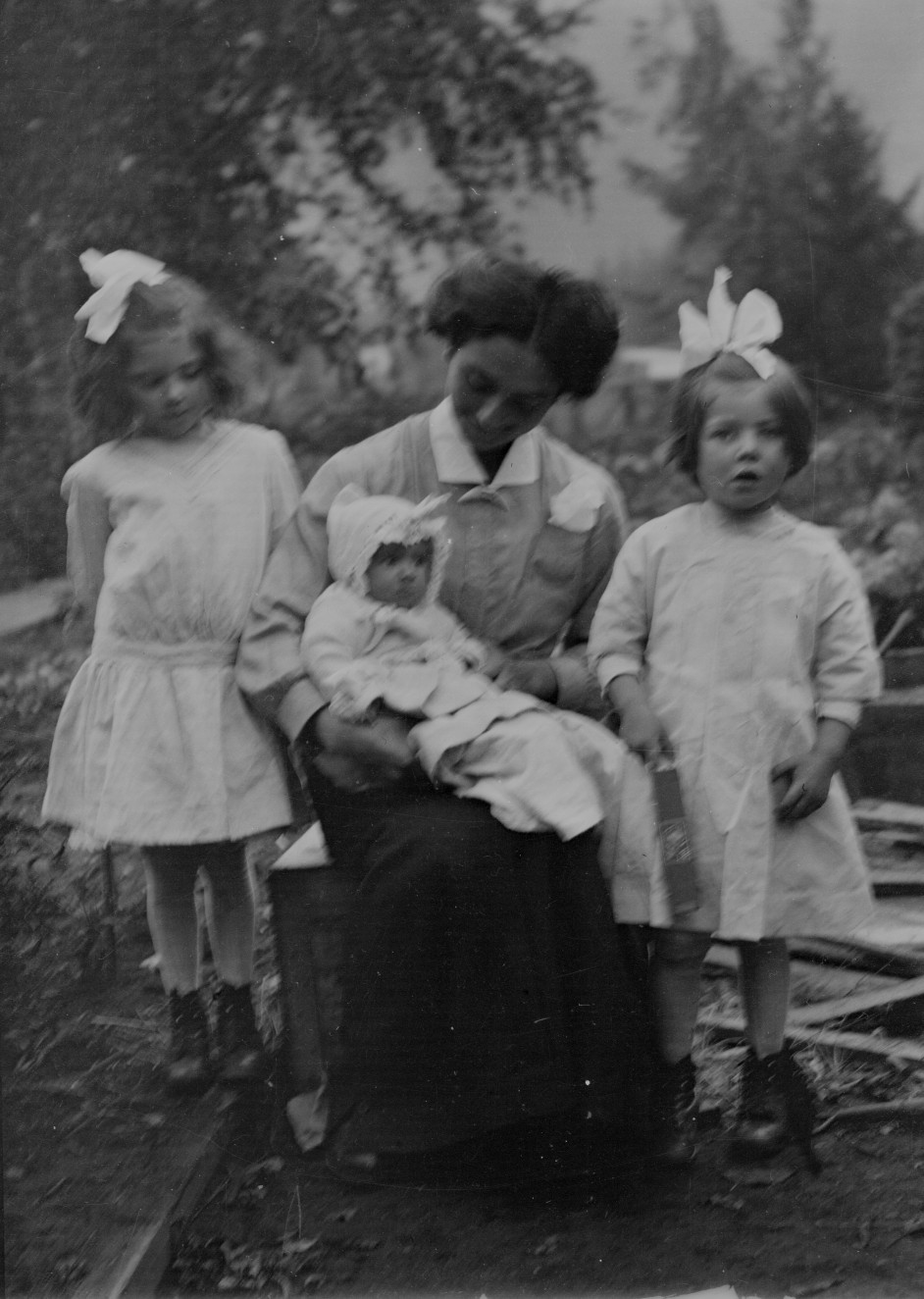 Helen, Aida, and Beatrice, with unknown relative in middle