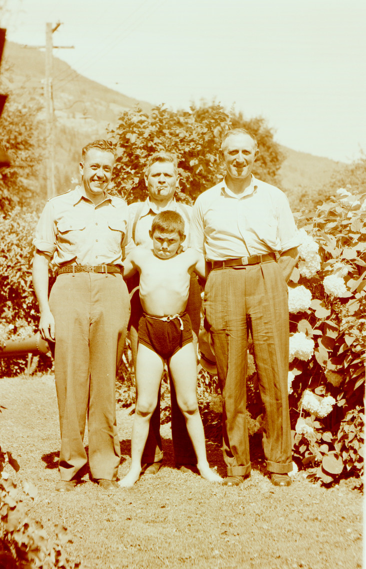 Muscle Boy with intense look (William Vining), Bill Freeman (left, smiling), Fred Southwell (top), and unknown (right)