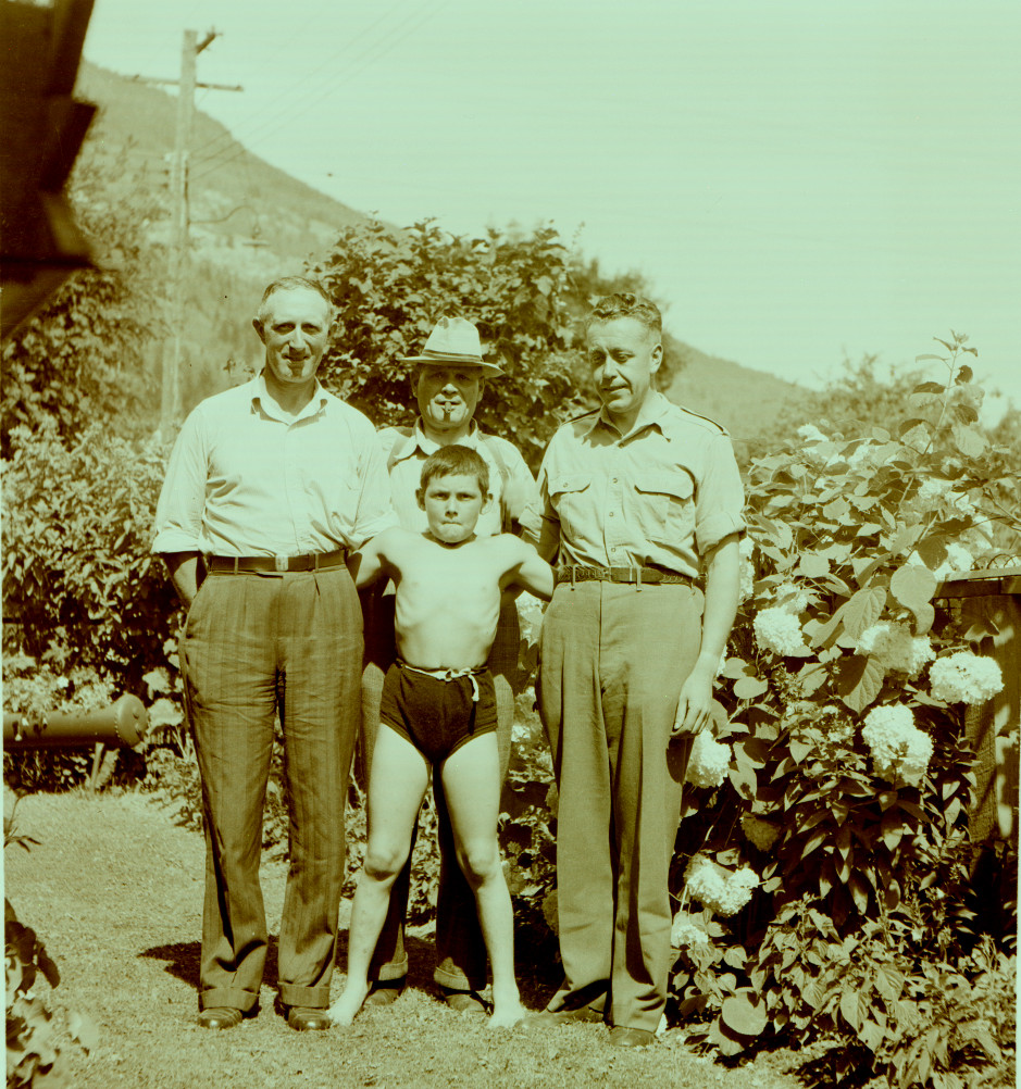 Muscle Boy in center (William Vining), Bill Freeman (right), Fred Southwell (in hat, top), and unknown (left)