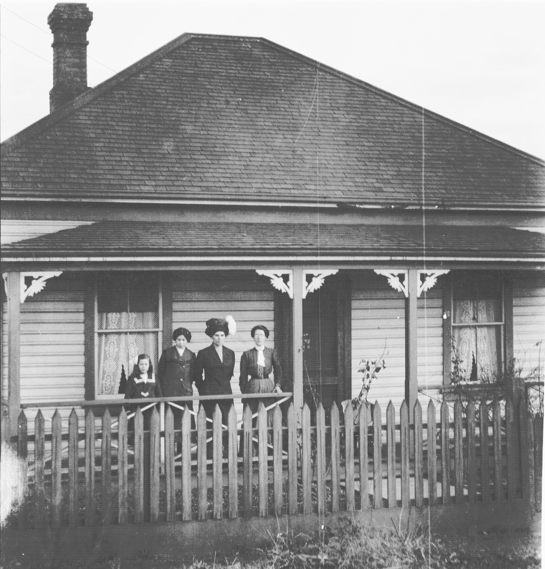 Three women and possibly Helen on porch - Second from right appears to be Kathleen Southwell