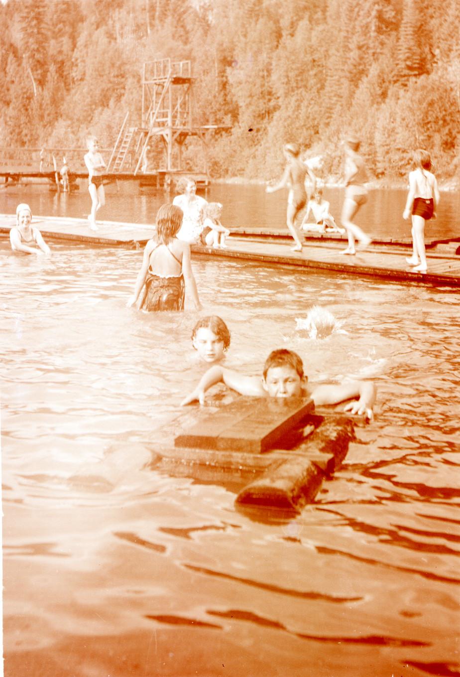 William Vining swimming with raft  - Williamson Lake