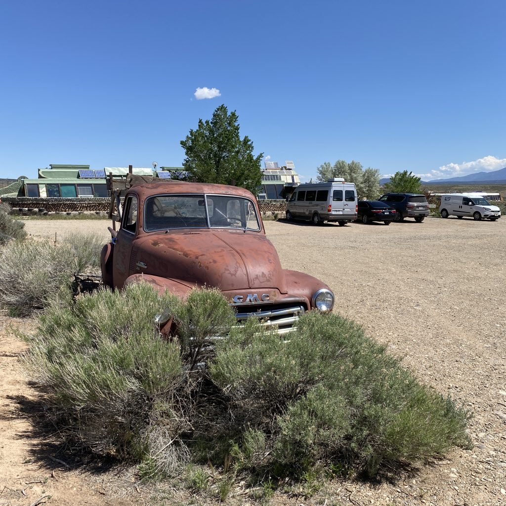 GMC Truck with Visitor's Center in Background
